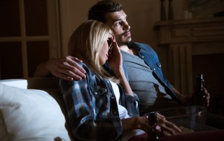 side view of woman closing eyes while watching movie with man