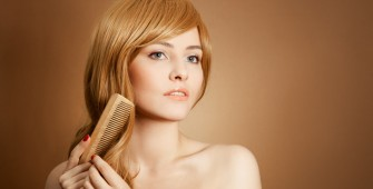 Beautiful Woman Combs Her Healthy Long Hair